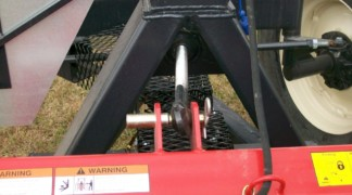 Third upper link bar for mower tip control
