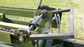 Head shaft roller to move loaded bale
